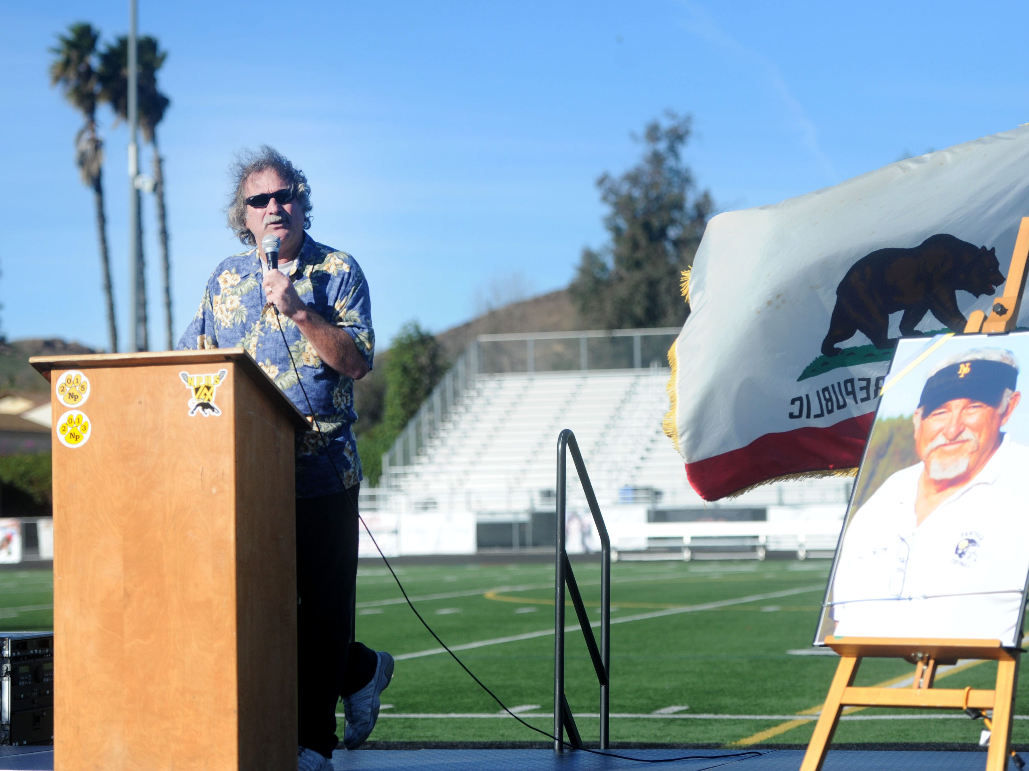 Gary Fabricius, who coached alongside George Hurley before becoming the head football coach at Newbury Park High, speaks during Saturday's tribute to Hurley at the Newbury Park football stadium that bears Hurley's name. Hurley died on Nov. 19.