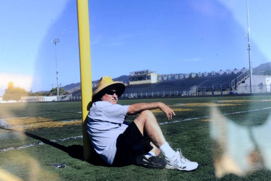 A photo of George Hurley relaxing at Newbury Park High football stadium was on display during a tribute to Hurley on Saturday at the stadium that now bears his name. Hurley died on Nov. 19.