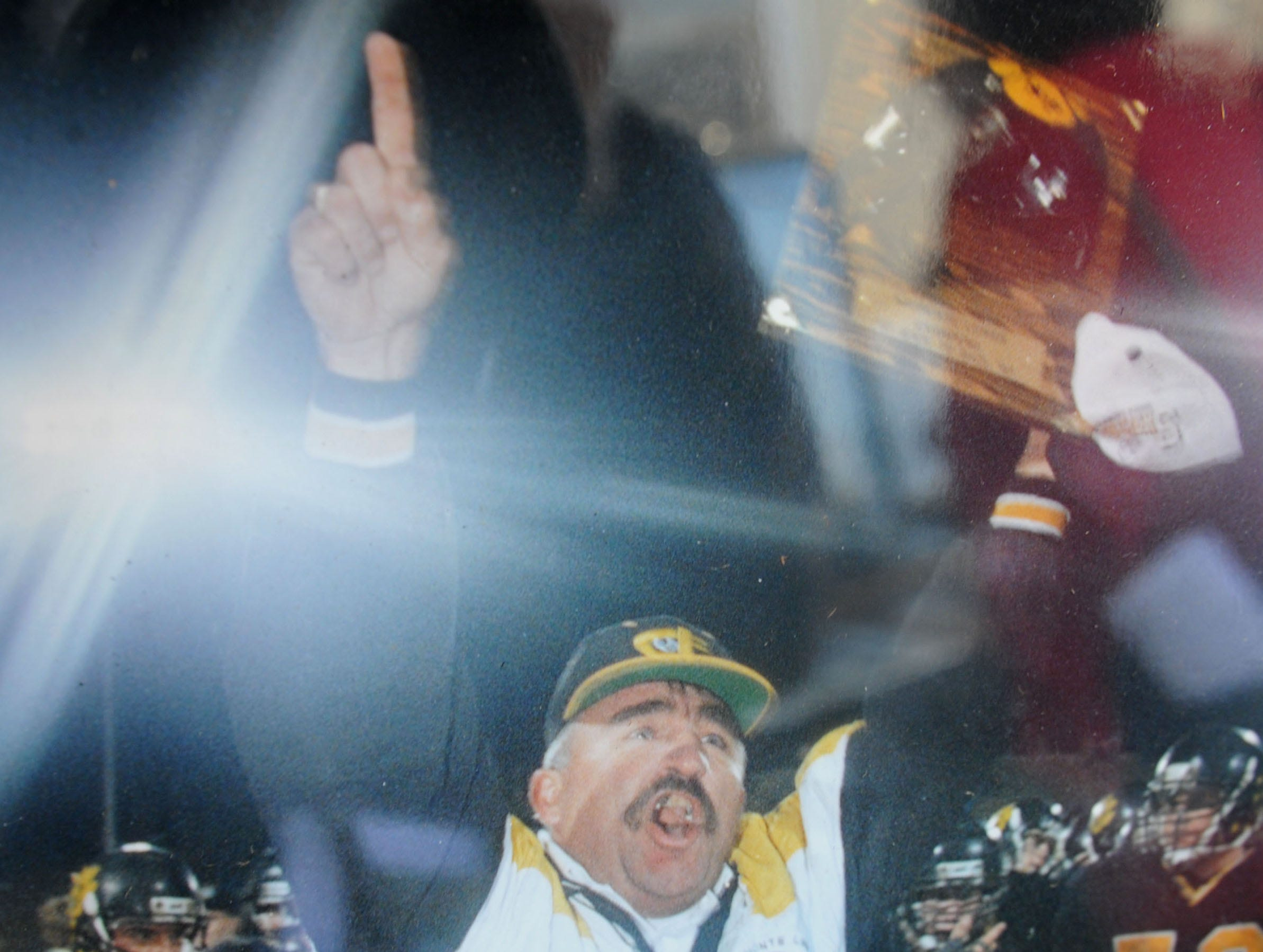 A photo of George Hurley celebrating after Newbury Park won the CIF football title in 1993 was on display during Saturday's tribute to Hurley at the school's football stadium that bears Hurley's name.
