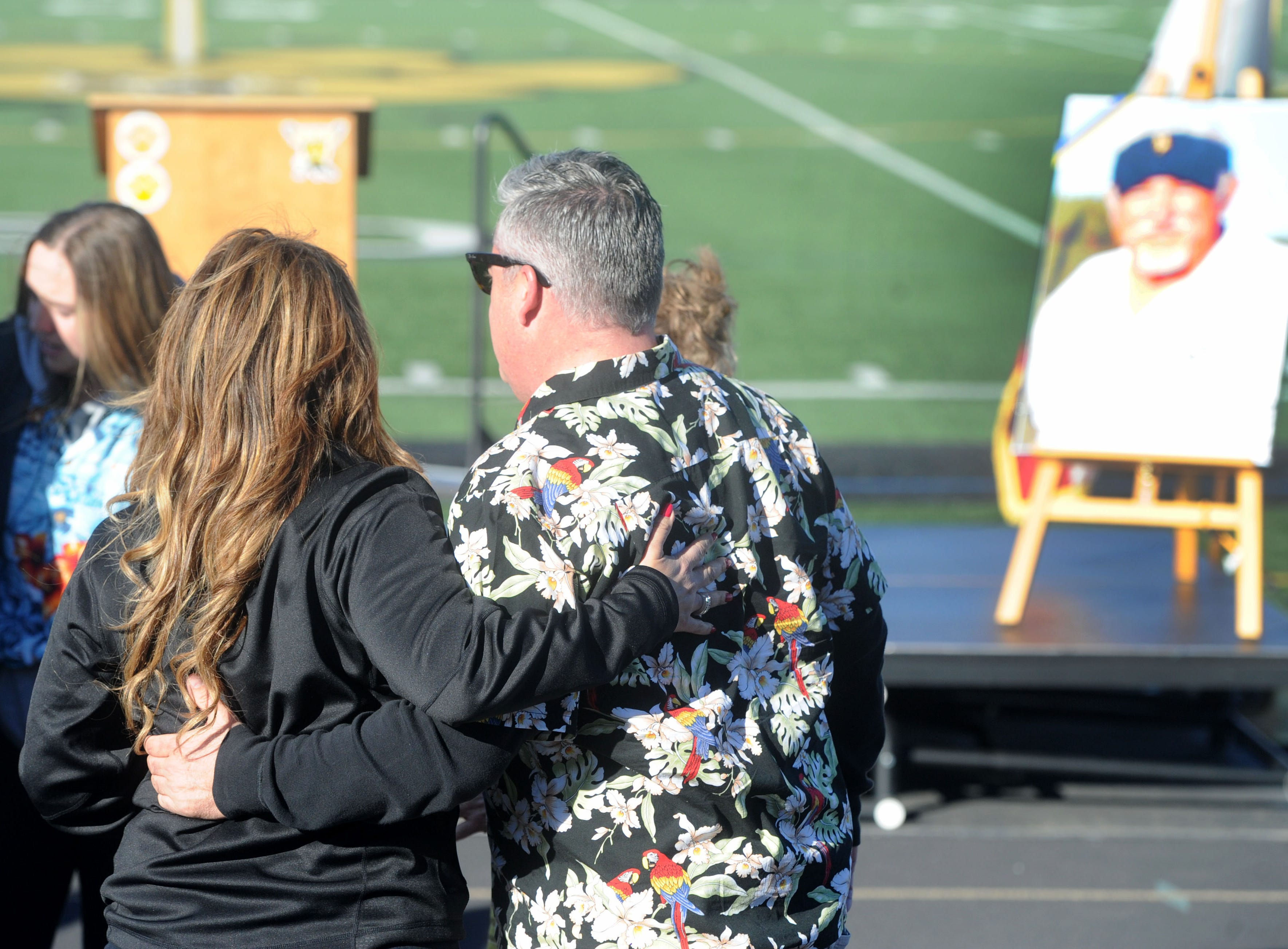 Well-wishers hug after the tribute to George Hurley at Newbury Park High on Saturday.