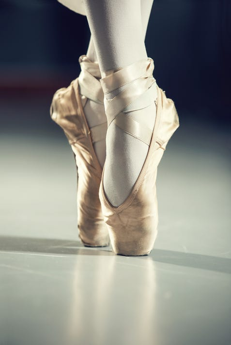 Dancer In Ballet Shoes Isolated On Gray