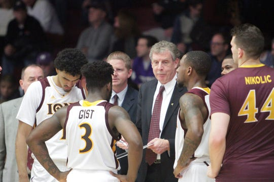 Iona head coach Tim Cluess talks with his players during a game at the Hynes Center earlier this season. Iona beat Rider 77-71 on Jan. 25, 2019.