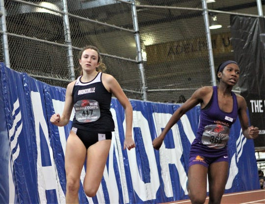 Bronxville's Eve Balseiro (l) competes in Marine Corps Invitational 300.