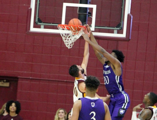 Holy Cross' Jehyve Floyd dunks on Iona's Andrija Ristanovic during a game at the Hynes Center in New Rochelle on Sunday, December 30th, 2018. Iona lost to Holy Cross 78-71.