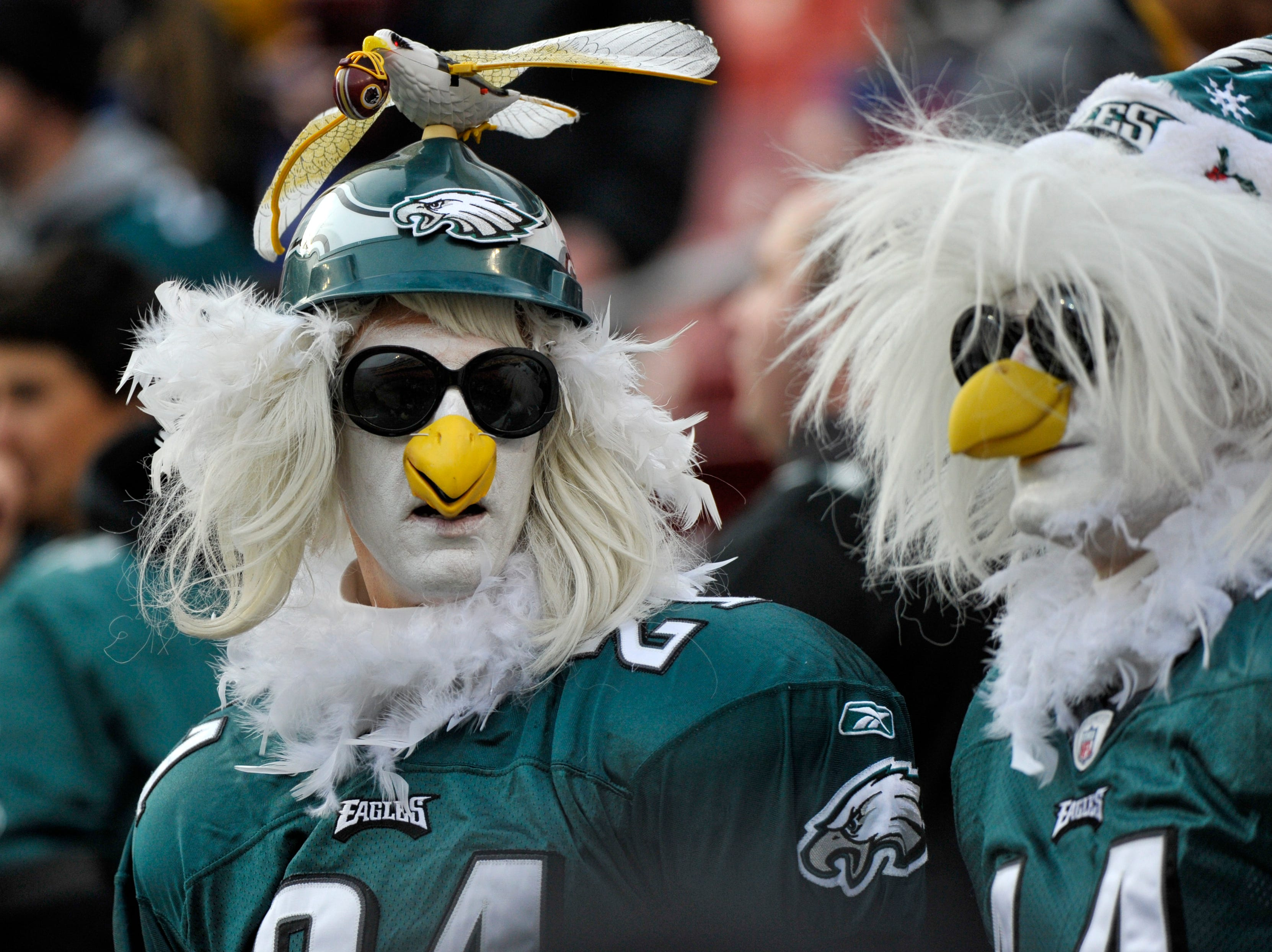 Philadelphia Eagles fans watch their team warm up before the NFL football game between the Washington Redskins and the Philadelphia Eagles, Sunday, Dec. 30, 2018 in Landover, Md. (AP Photo/Mark Tenally)