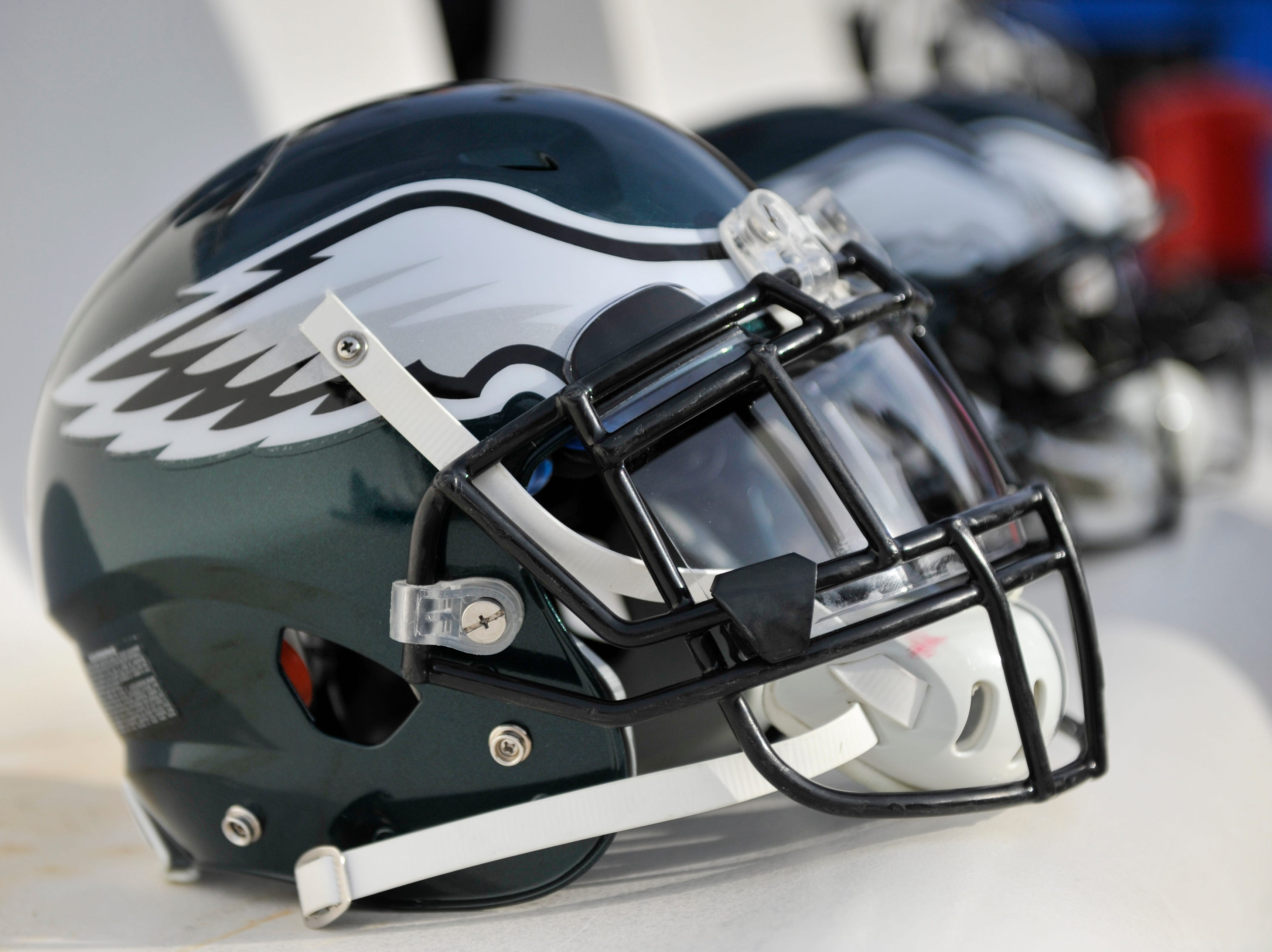 Philadelphia Eagles helmets sit on the bench before the NFL football game between the Washington Redskins and the Philadelphia Eagles, Sunday, Dec. 30, 2018 in Landover, Md. (AP Photo/Mark Tenally)
