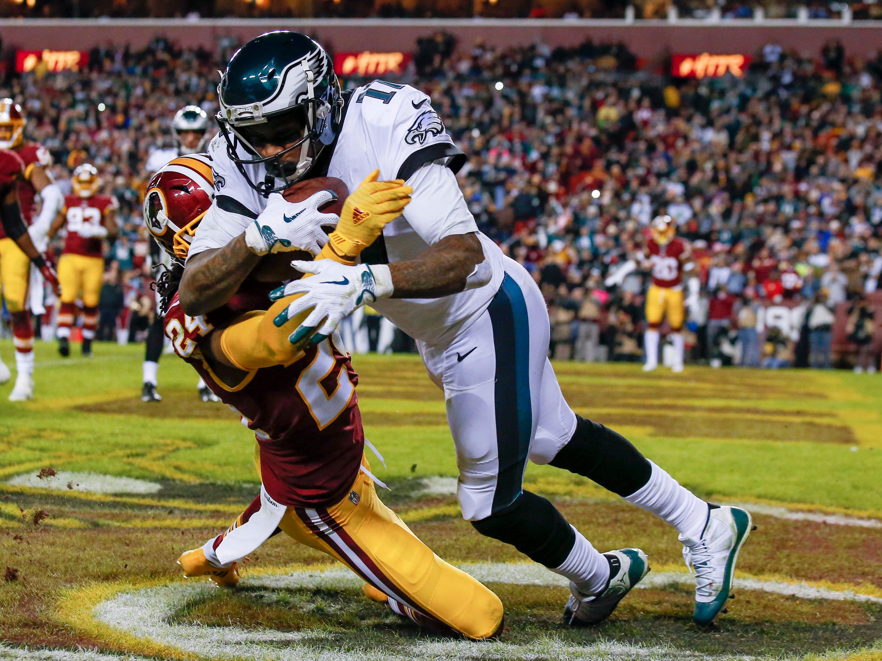 Philadelphia Eagles wide receiver Alshon Jeffery (17) pulls in a touchdown pass under pressure from Washington Redskins cornerback Josh Norman (24) during the first half of the NFL football game, Sunday, Dec. 30, 2018 in Landover, Md. (AP Photo/Alex Brandon)