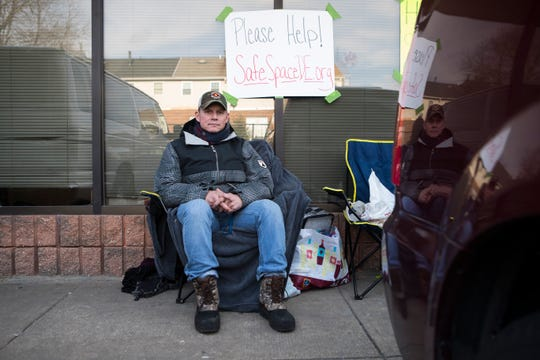 Mark Puican camps out in front of SafeSpace Delaware to help raise awareness of the shelter's official closing on Monday. He's spent his time bonding with the residents and spreading their stories through his social media accounts.