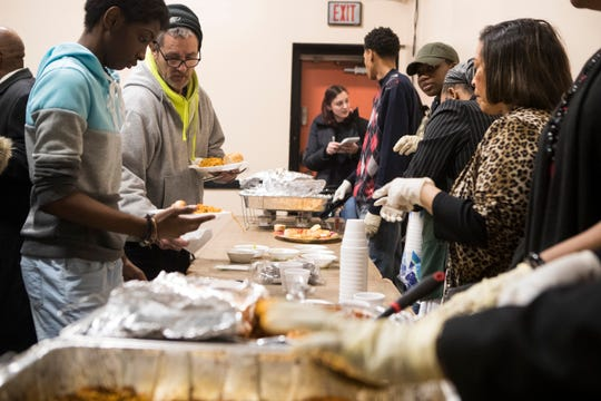 Members of Sanctuary Baptist Church volunteer serving dinner at SafeSpace Delaware Sunday afternoon.