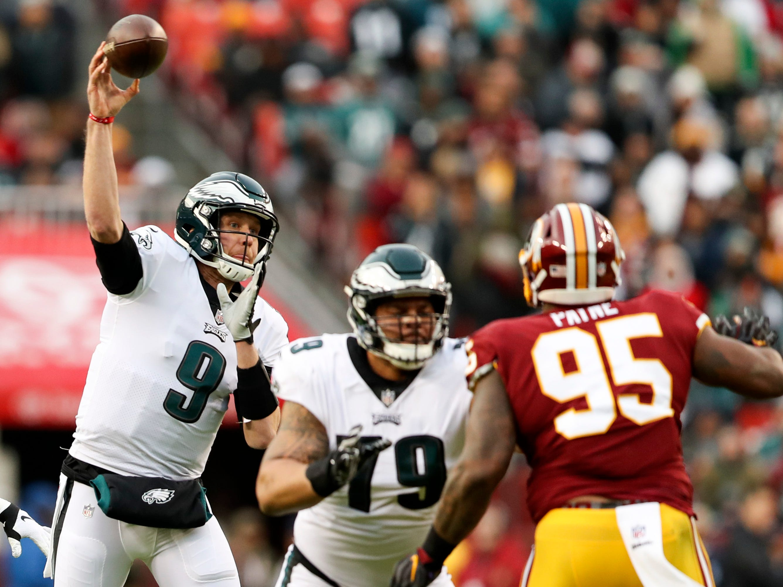 Philadelphia Eagles quarterback Nick Foles (9) passes the ball during the first half of an NFL football game against the Washington Redskins, Sunday, Dec. 30, 2018 in Landover, Md. (AP Photo/Andrew Harnik)