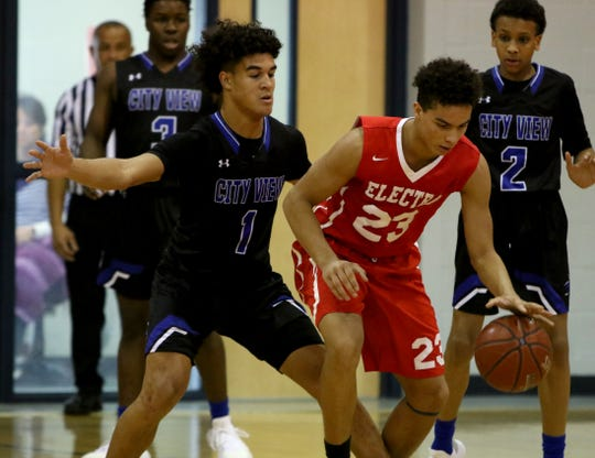 Electra's Jailen Dixon dribbles while guarded by City View's Jayln Marks at the Windthorst Tournament Saturday, Dec. 29, 2018, in Windthorst.