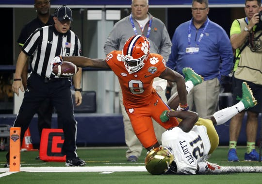 Clemson wide receiver Justyn Ross (8) leans forward and reaches the end zone for a touchdown after getting past Notre Dame safety Jalen Elliott (21) in the first half of the NCAA Cotton Bowl semi-final playoff football game, Saturday, Dec. 29, 2018, in Arlington, Texas.  Ross scored two TDs and caught six passes for 148 yards.