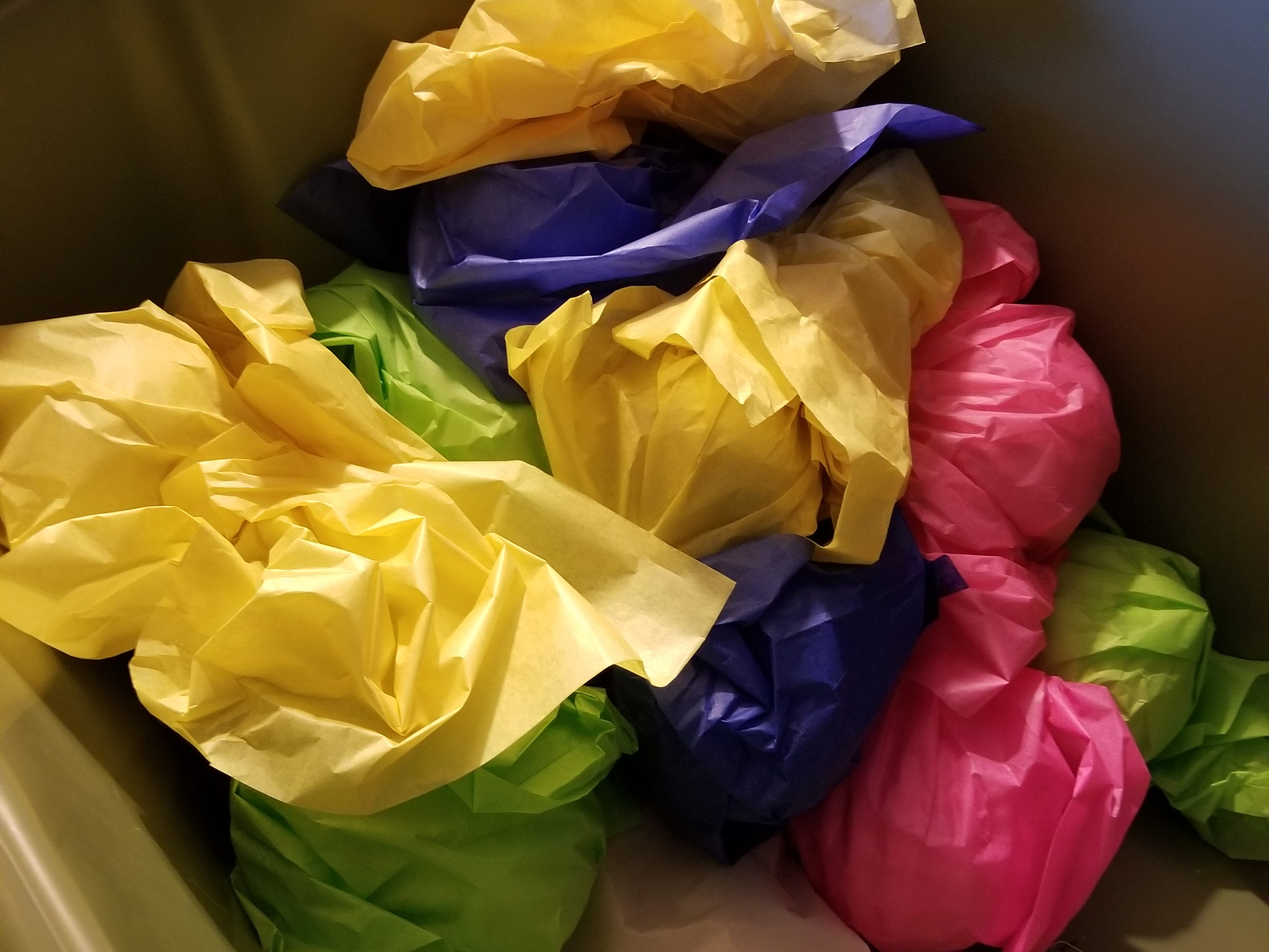 If you have ornaments that are larger, purchase some tissue paper from your local dollar store.  Wrap each ornament in the tissue and tuck  into your packing bin.