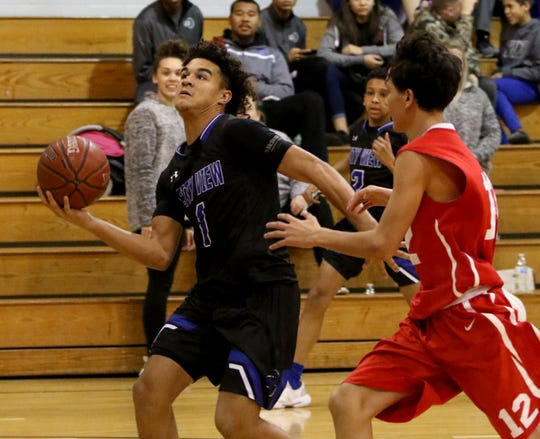 City View's Jayln Marks looks to the basket by Electra's Luke Barrera at the Windthorst Tournament Saturday, Dec. 29, 2018, in Windthorst.