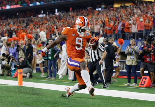 Clemson running back Travis Etienne celebrates after scoring a touchdown against Notre Dame in the 2018 Cotton Bowl.