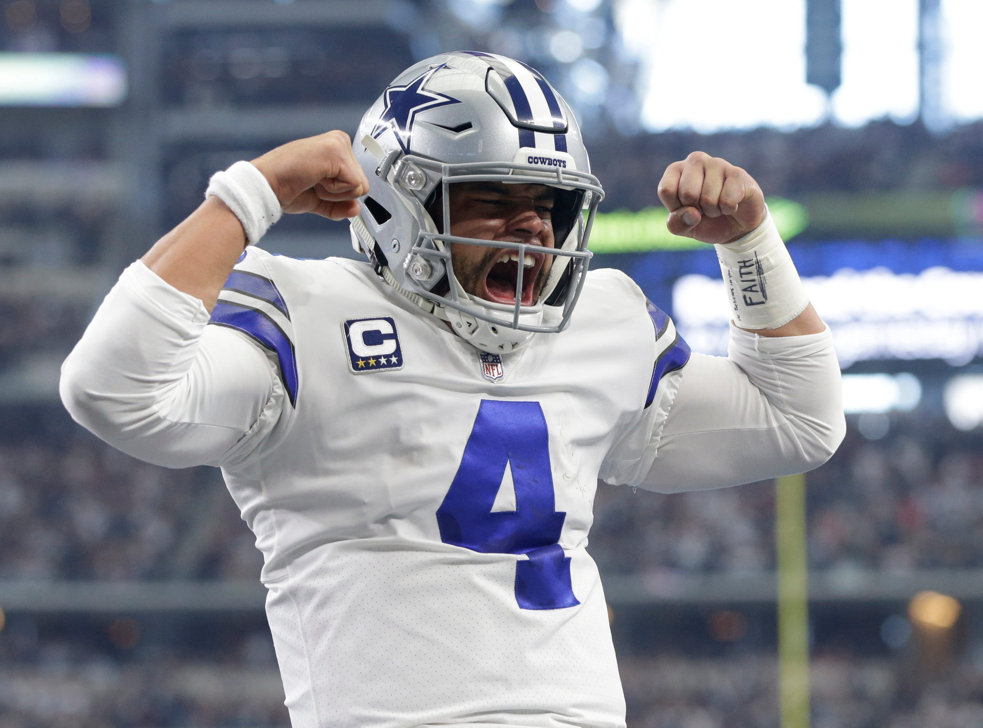 Dec. 23: Dallas Cowboys quarterback Dak Prescott reacts after running for a touchdown in the first quarter against the Tampa Bay Buccaneers at AT&T Stadium.