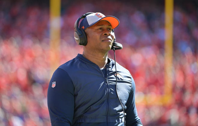 Denver Broncos head coach Vance Joseph watches the replay screen during the second half against the Kansas City Chiefs at Arrowhead Stadium.