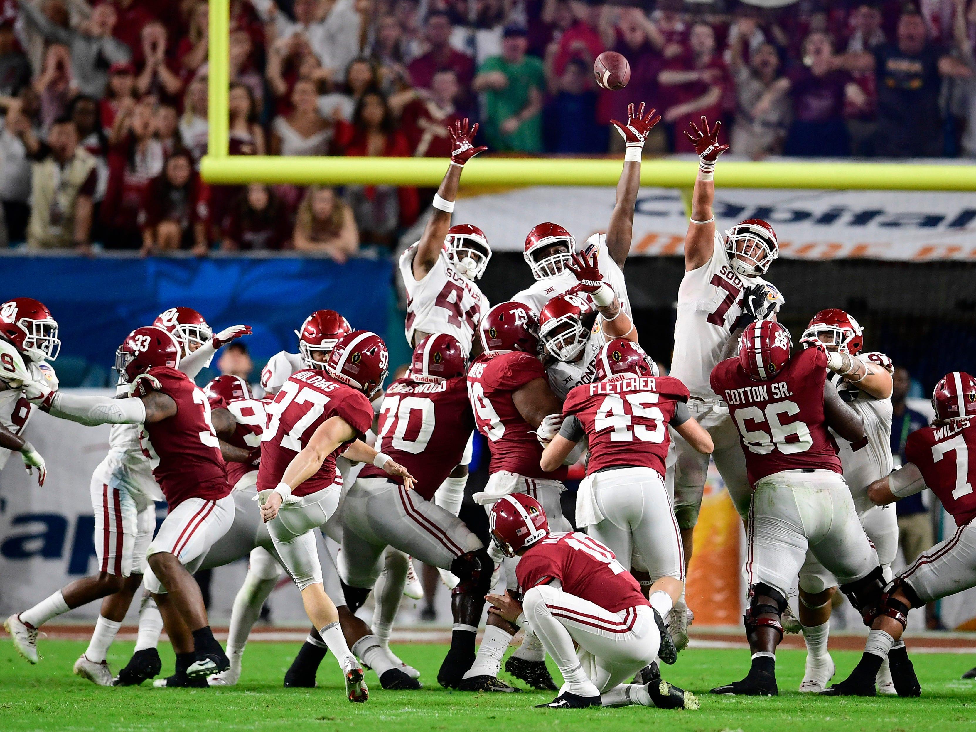 Orange Bowl: Alabama place kicker Joseph Bulovas kicks a field goal.