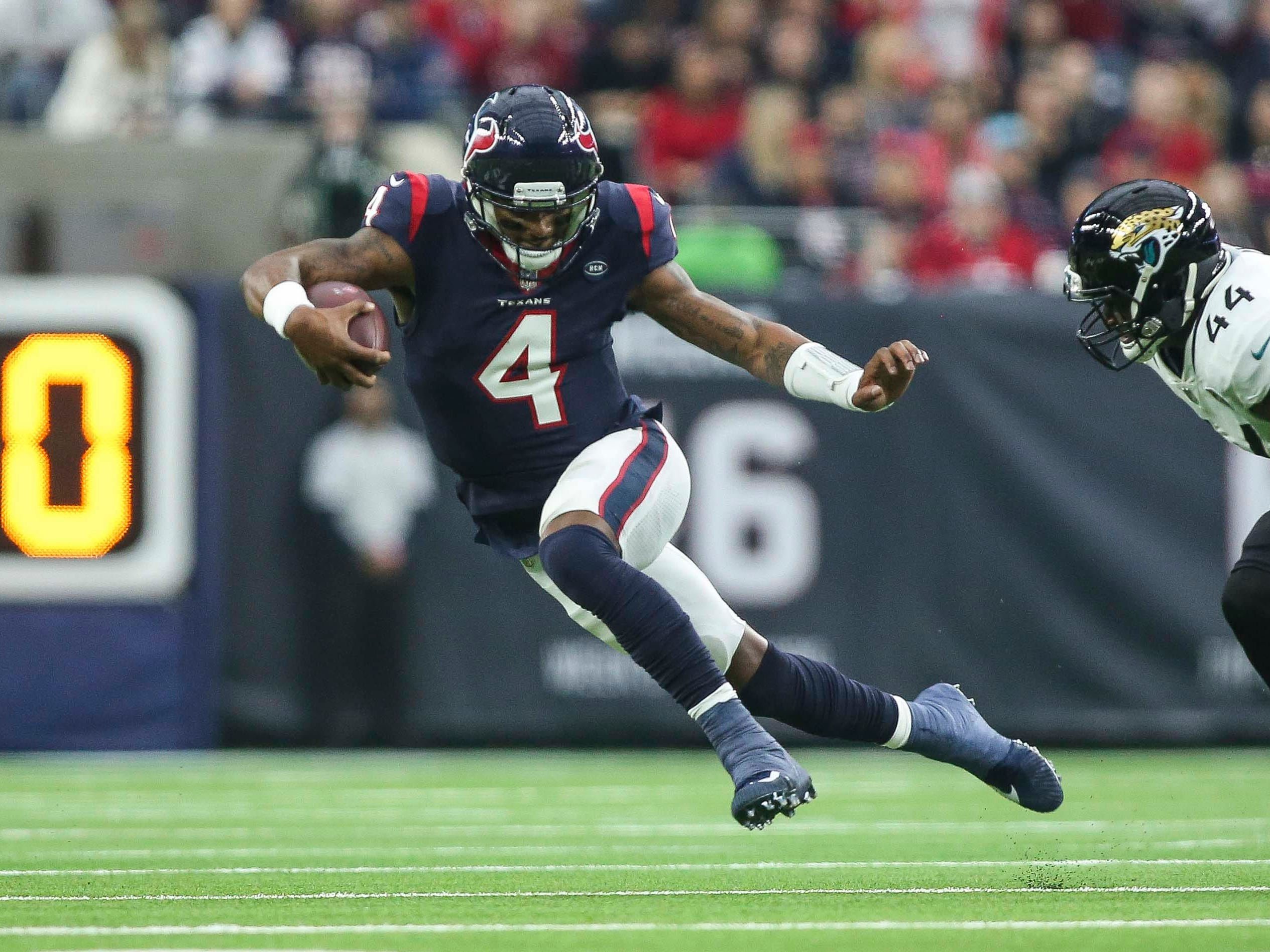Week 17: Houston Texans quarterback Deshaun Watson (4) runs with the ball during the first quarter against the Jacksonville Jaguars at NRG Stadium.
