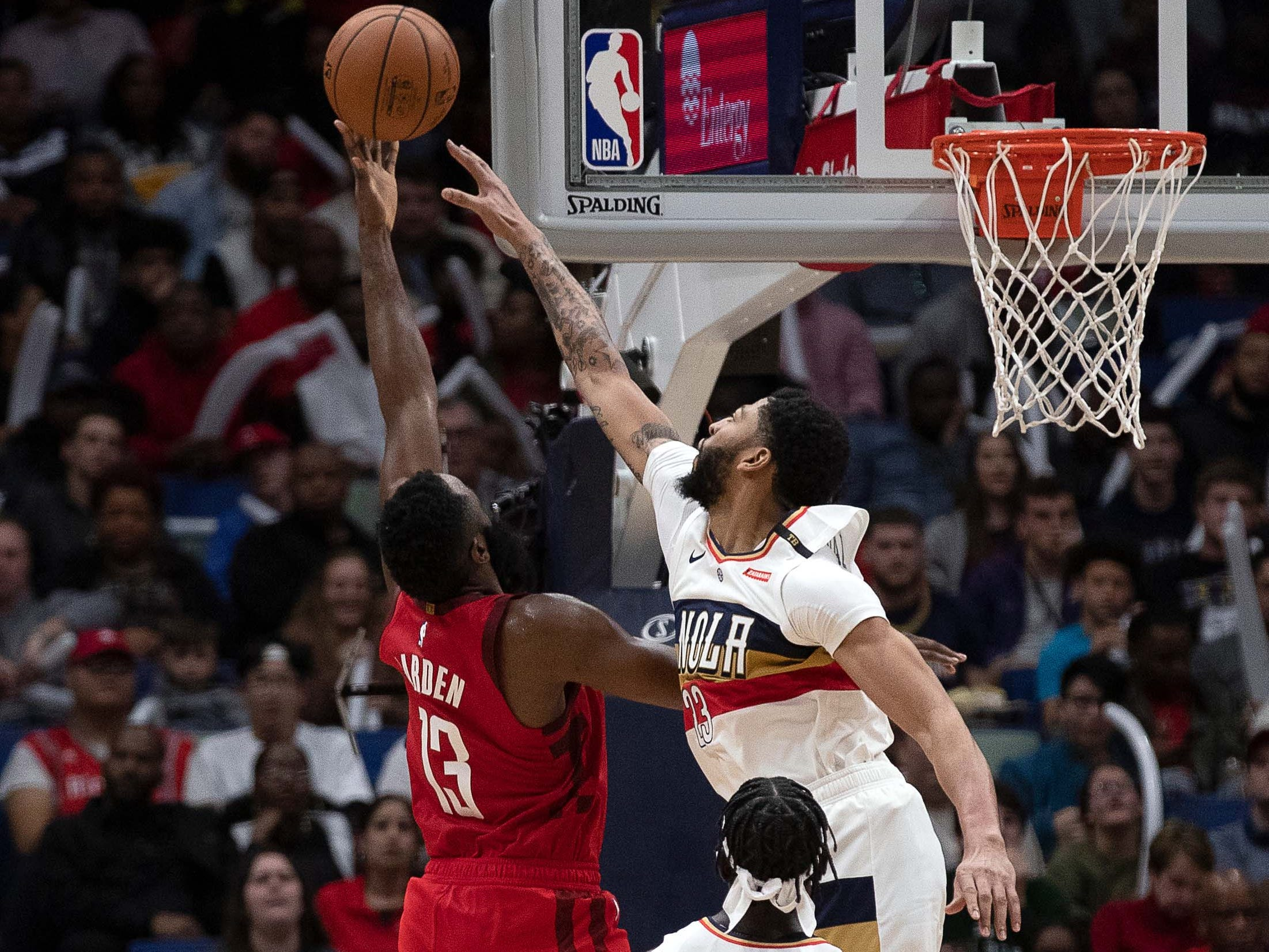 Dec. 29: Rockets guard James Harden (13) gets his shot just over the out-stretched arm of Pelicans defender Anthony Davis (23) during the second half in New Orleans.