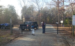 Two volunteers at the Conservation Center lock up the entrance gate after a lion attacked and killed an intern who was doing routine cleaning Sunday, Dec. 30, 2018, north of Burlington, N.C.