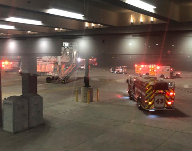 Emergency personnel respond after an equipment failure involving a jet bridge at Baltimore-Washington International Thurgood Marshall Airport on Dec. 29, 2018, in Baltimore.