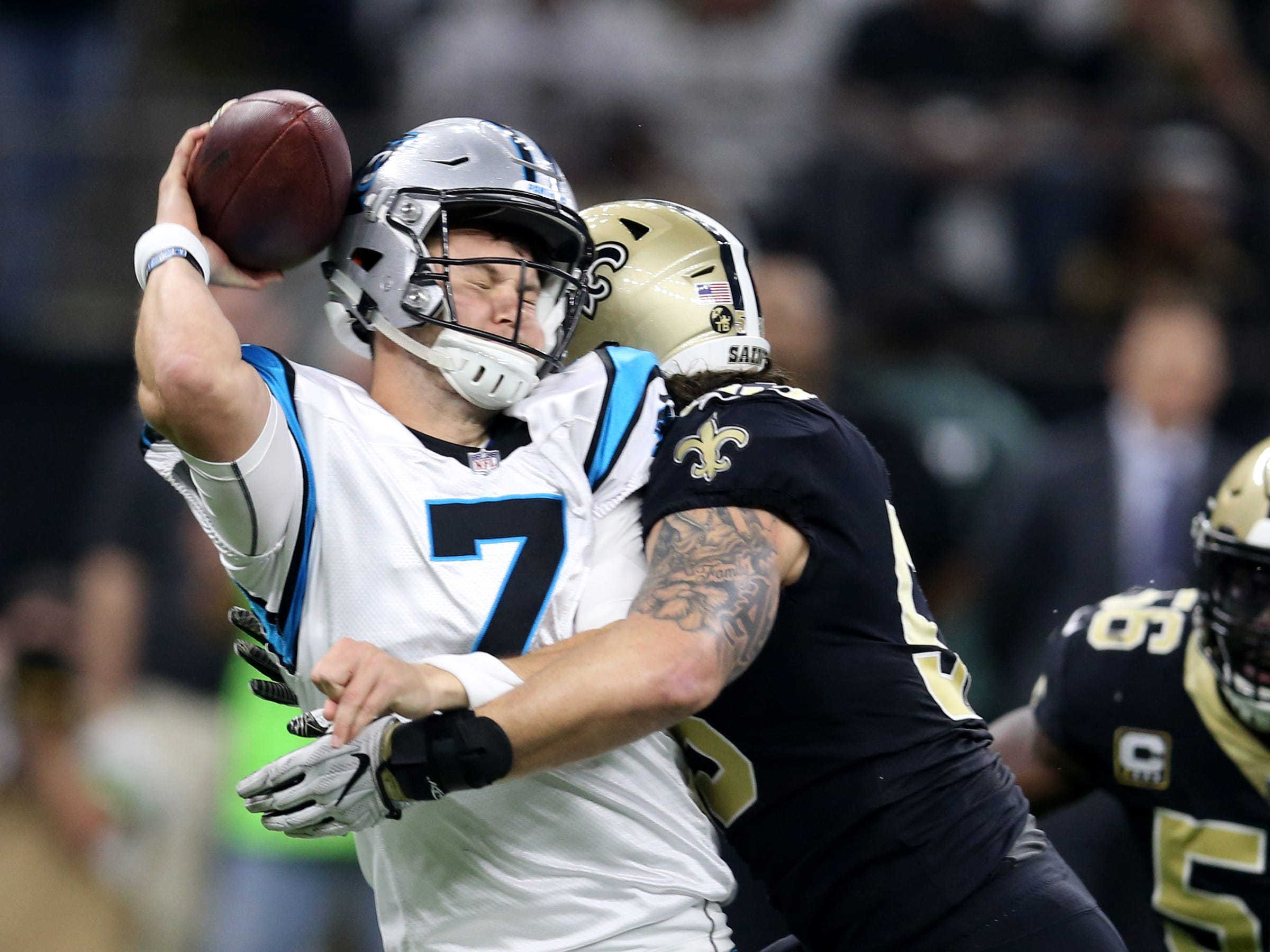Week 17: Carolina Panthers quarterback Kyle Allen (7) is hit by New Orleans Saints outside linebacker A.J. Klein (53) in the first quarter at the Mercedes-Benz Superdome.
