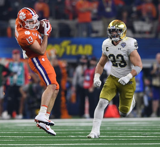 Clemson wide receiver Hunter Renfrow (13) catches a pass past Notre Dame linebacker Drue Tranquill (23) during the 2nd quarter of the Goodyear Cotton Bowl at AT&T stadium in Arlington, TX Saturday, December 29, 2018.