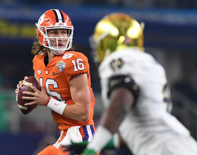 Clemson quarterback Trevor Lawrence (16) looks to pass against Notre Dame during the 2nd quarter of the Goodyear Cotton Bowl at AT&T stadium in Arlington, TX Saturday, December 29, 2018.