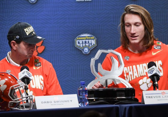 Clemson Head Coach Dabo Swinney, left, looks toward quarterback Trevor Lawrence (16) answering questions after the College Football Playoff Semifinal 30-3 win over Notre Dame at the Goodyear Cotton Bowl Classic at AT&T Stadium in Arlington, Texas Saturday, December 29, 2018. Lawrence was named MVP.