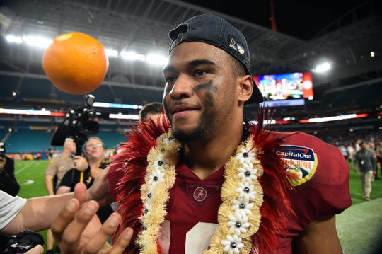 Dec 29, 2018; Miami Gardens, FL, USA; Alabama Crimson Tide quarterback Tua Tagovailoa (13) celebrates with an orange after defeating the Oklahoma Sooners in the 2018 Orange Bowl college football playoff semifinal game at Hard Rock Stadium. Mandatory Credit: Jasen Vinlove-USA TODAY Sports