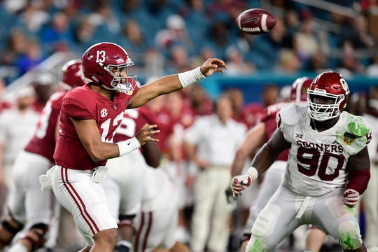Dec 29, 2018; Miami Gardens, FL, USA; Alabama Crimson Tide quarterback Tua Tagovailoa (13) throws the ball past Oklahoma Sooners defensive lineman Neville Gallimore (90) during the first half of the 2018 Orange Bowl college football playoff semifinal game at Hard Rock Stadium. Mandatory Credit: Tommy Gilligan-USA TODAY Sports
