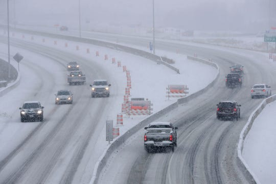 Traffic moves slowly along State 441  in Fox Crossing during a snow storm Monday.