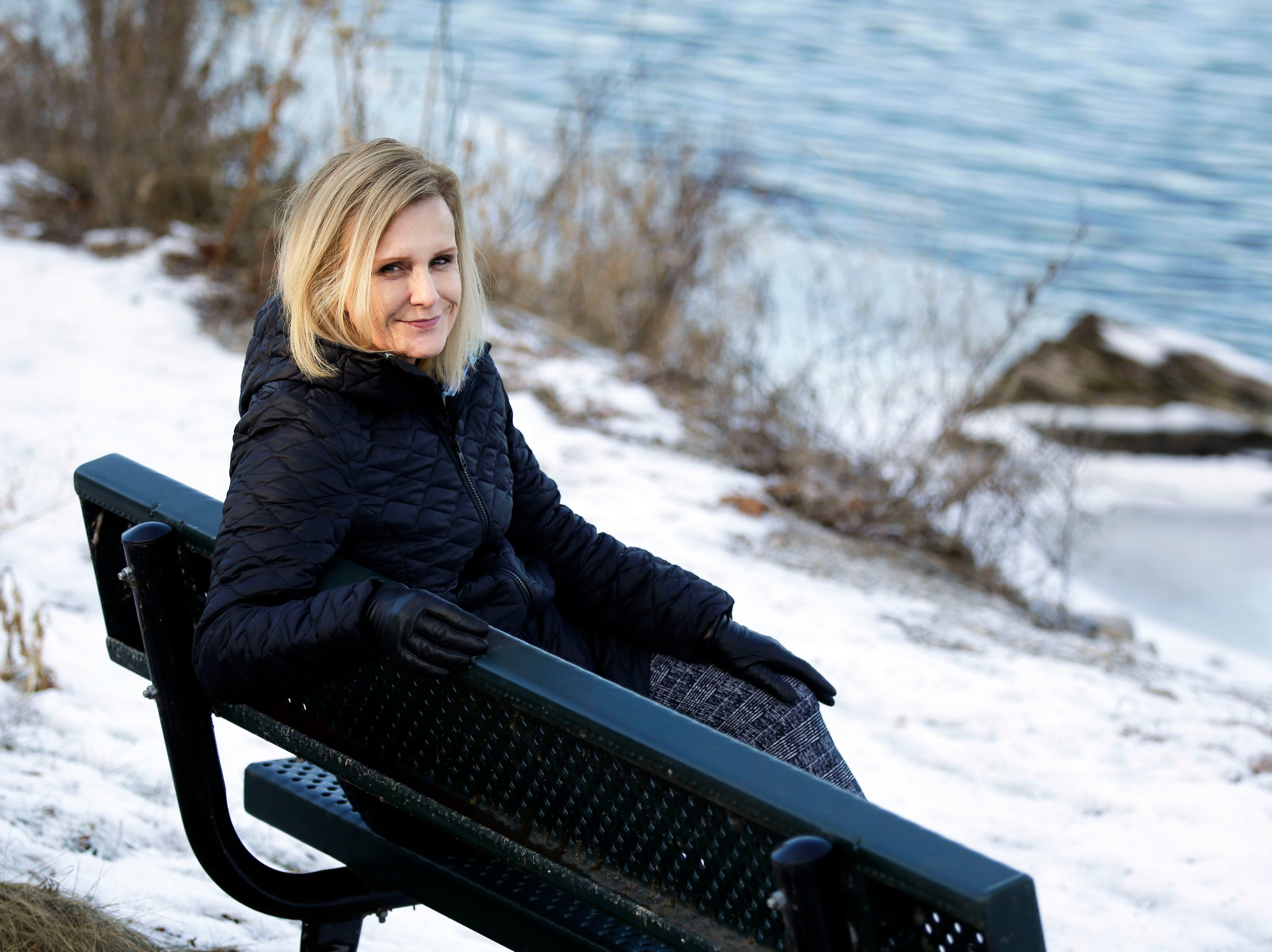 Lisa Hanneman sits on a memorial bench at the 1000 Islands Environmental Center near where her son, Nate, fished when he was younger. Nate died from brain cancer at 24.