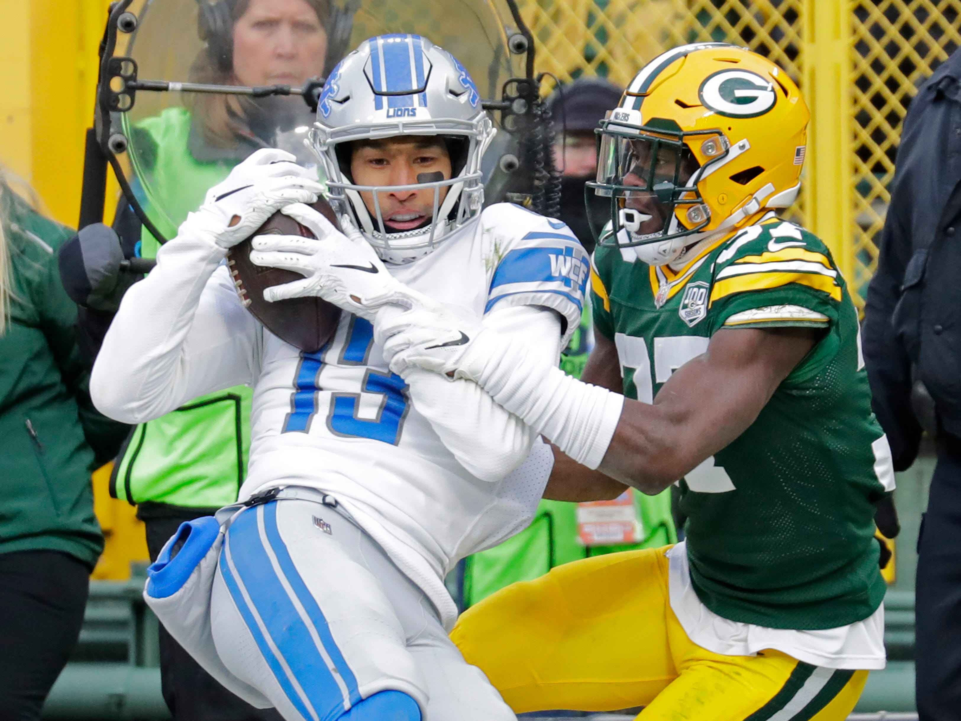Detroit Lions wide receiver T.J. Jones (13) pulls down a touchdown against Green Bay Packers cornerback Josh Jackson (37) in the fourth quarter Sunday, December 30, 2018, at Lambeau Field in Green Bay, Wis. 