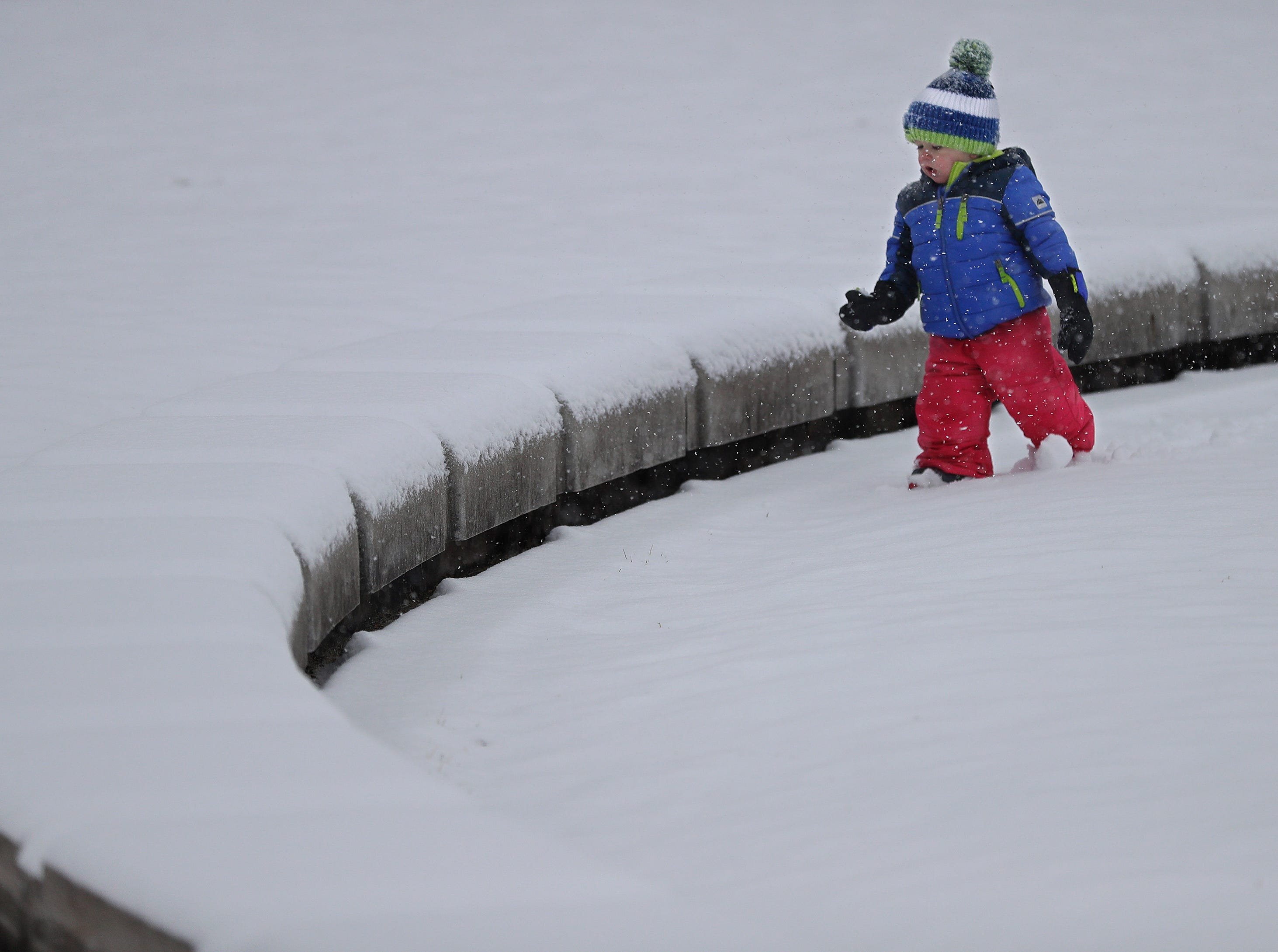 Everette Mott, 1, of Neenah, plays in the snow at Shattuck Park during a snow storm Monday, December 31, 2018, in Neenah, Wis. Everette was with his family.Dan Powers/USA TODAY NETWORK-Wisconsin