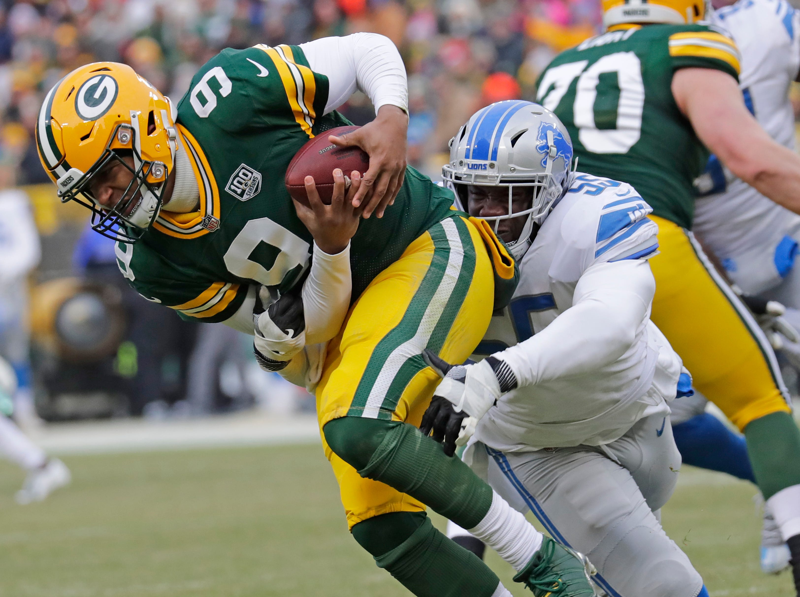 Green Bay Packers quarterback DeShone Kizer (9) gets scrambles away from Detroit Lions defensive end Eric Lee (55) in the fourth quarter Sunday, December 30, 2018, at Lambeau Field in Green Bay, Wis. 