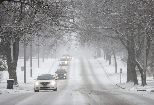 Traffic moves slowly along W. Prospect Avenue during a snow storm Monday, December 31, 2018, in Appleton, Wis. 