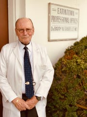 Dr. Barry Grabelle outside his office building in Eatontown.