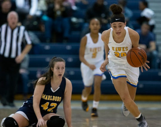Manchester's Destiny Adams steals the ball and heads back down court during first half action. 2018 WOBM Christmas Classic Girls and Boys Basketball Finals in Toms River on December 30, 2018.