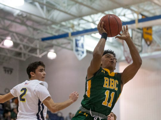 Red Bank Catholic's MJ Wright drives to the basket during first half action. 2018 WOBM Christmas Classic Girls and Boys Basketball Finals in Toms River on December 30, 2018.