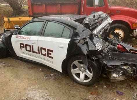 This Woodfin police cruiser was struck on the side of Interstate 40 in Haywood County Friday after an off-duty officer stopped to help people involved in a crash.