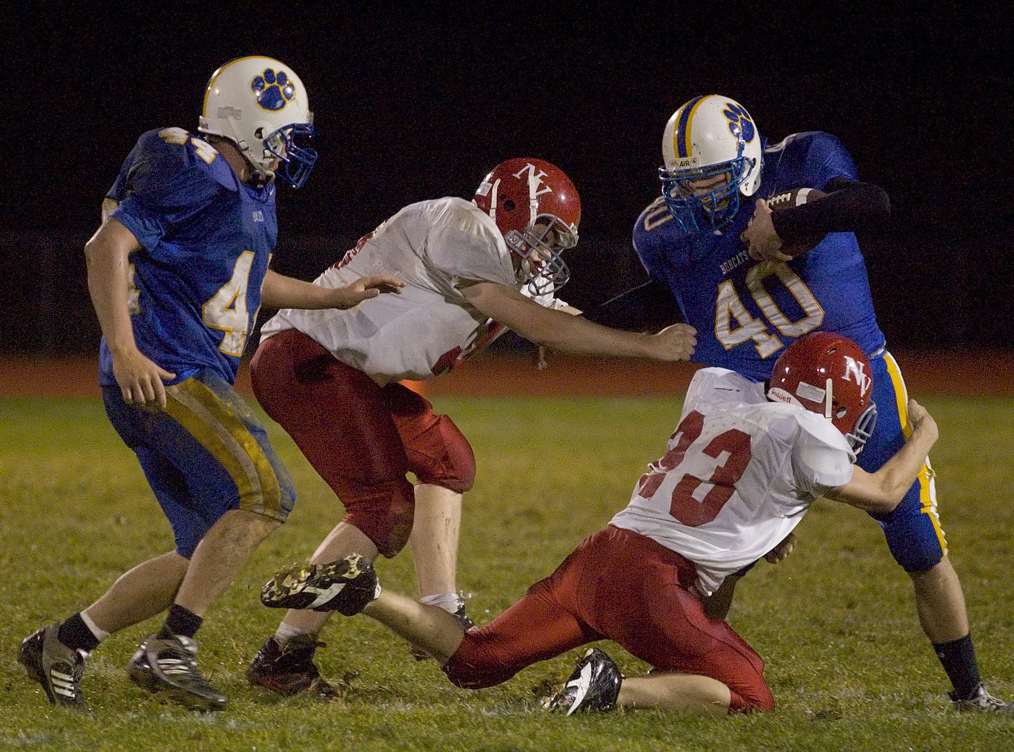 From 2009: Lansing's 44 Colden Knapp far left runs to help as Newark Valley's Spencer Dunn left and John Stagg right pull down Lansing's Ryan Todd during the second quarter of the game on Friday at Lansing.