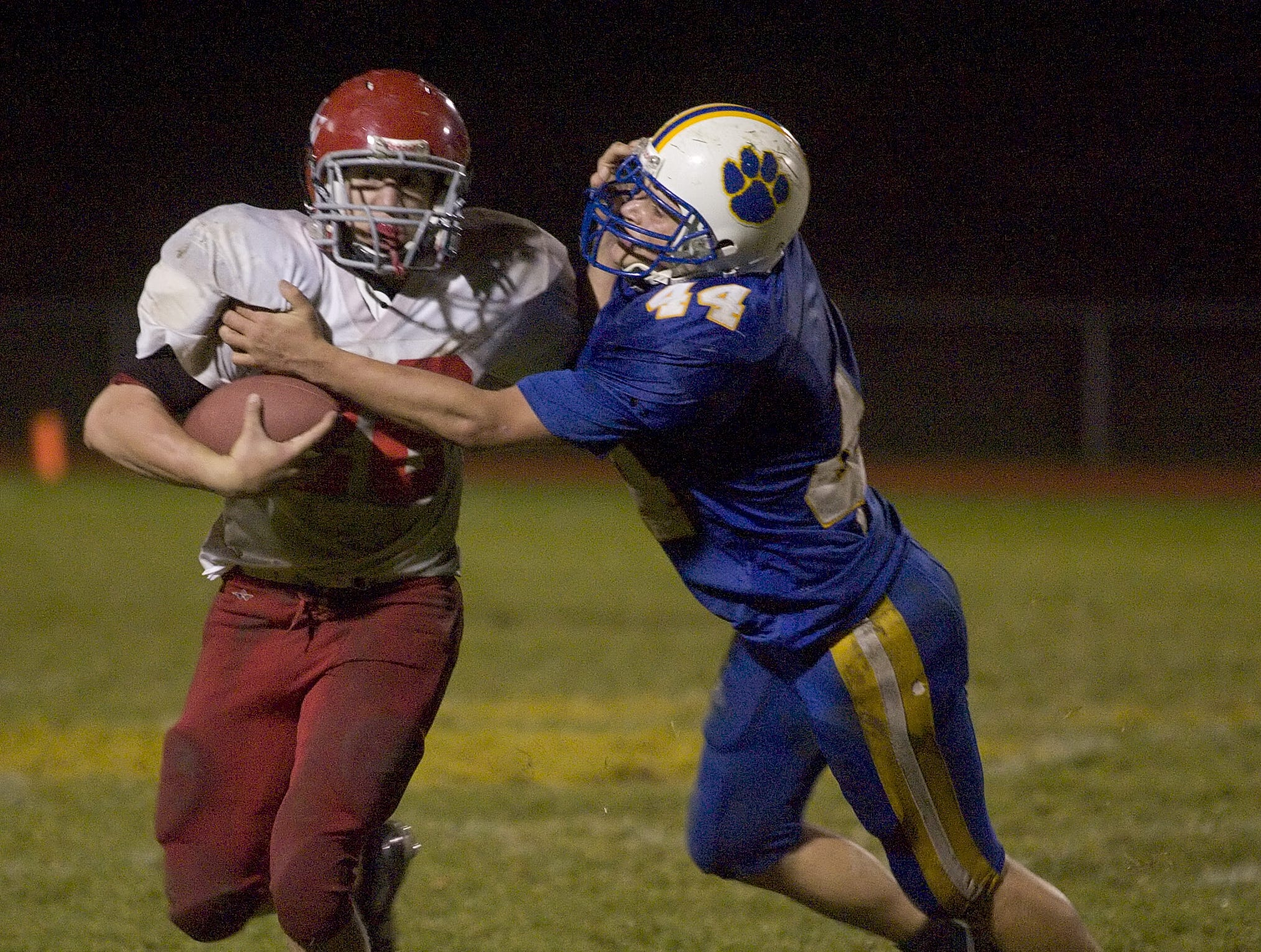 From 2009: Newark Valley's Travis French is pulled down by Lansing's Colden Knapp during the first quarter of the game on Friday at Lansing.