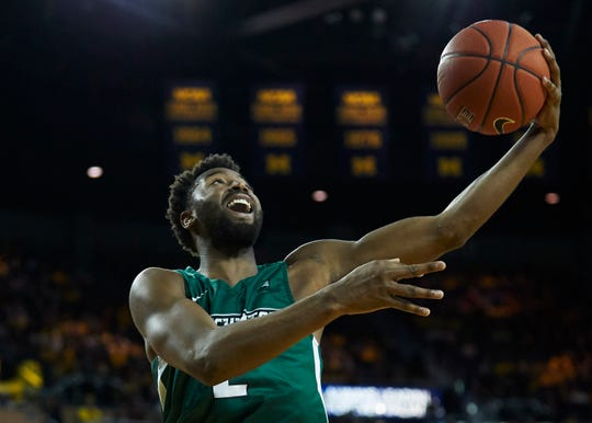 Binghamton Bearcats forward Chancellor Barnard (2) shoots in the second half against the Michigan Wolverines at Crisler Center.