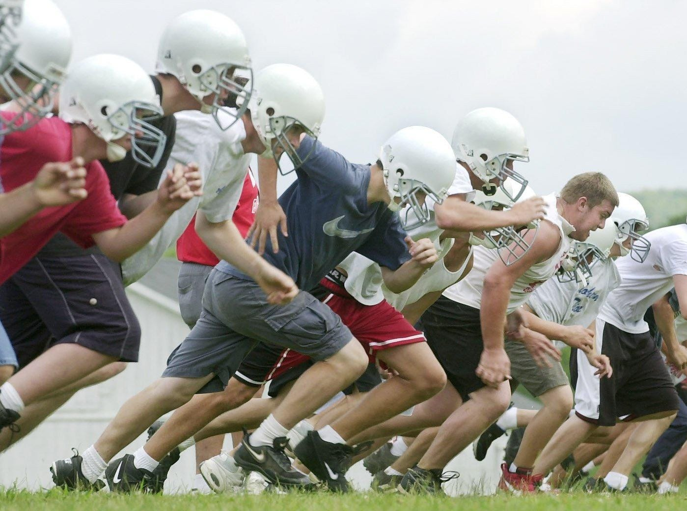From 2001: Newark Valley High School football team sprinting during practice.