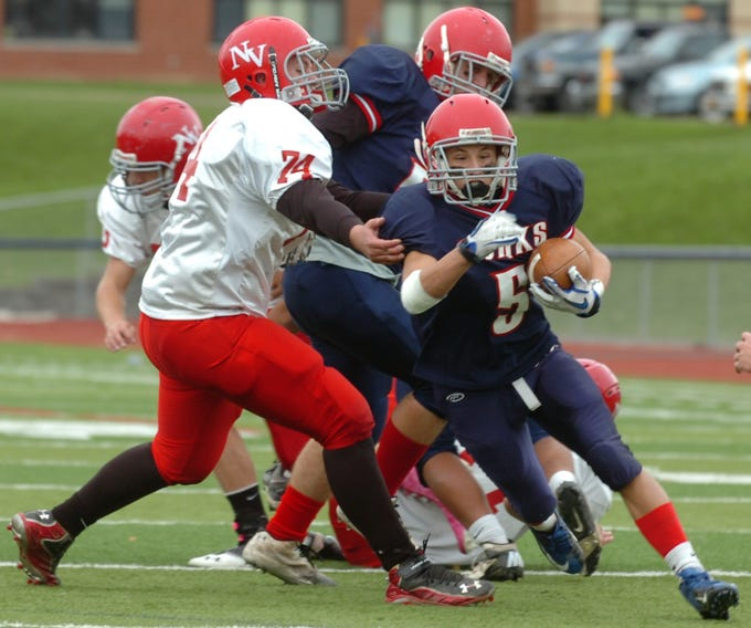 From 2012: Chenango Forks' Jake Green escapes from Newark Valley's Craig Wade in the second half Saturday. The Blue Devils rolled to a 45-3 victory.