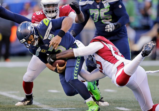 Seahawks quarterback Russell Wilson was sacked six times in Sunday's win over the Arizona Cardinals.