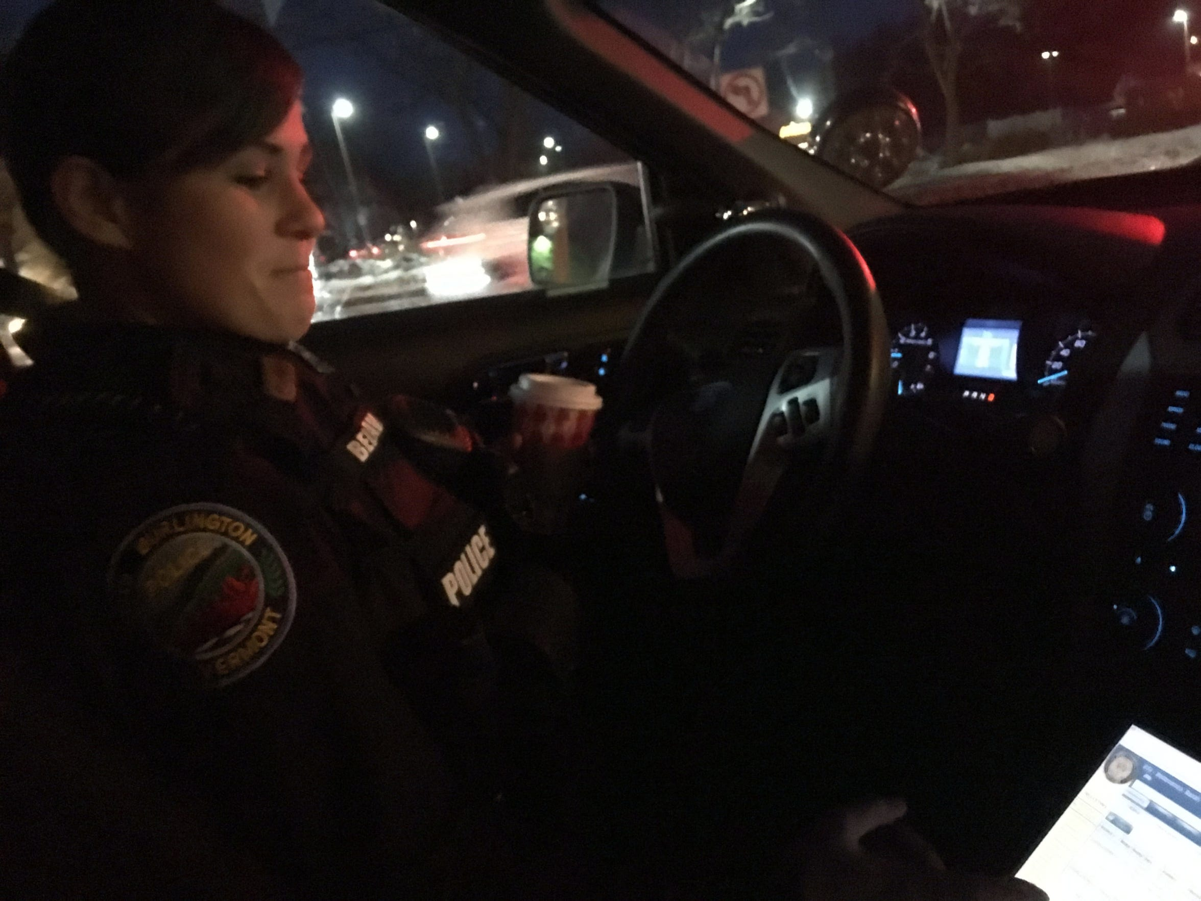 While stopped in a parking lot, South Burlington Police Officer Sarah Bellavance checks Valcour to see which incidents were open and which area she was assigned to patrol on Dec. 6, 2018.