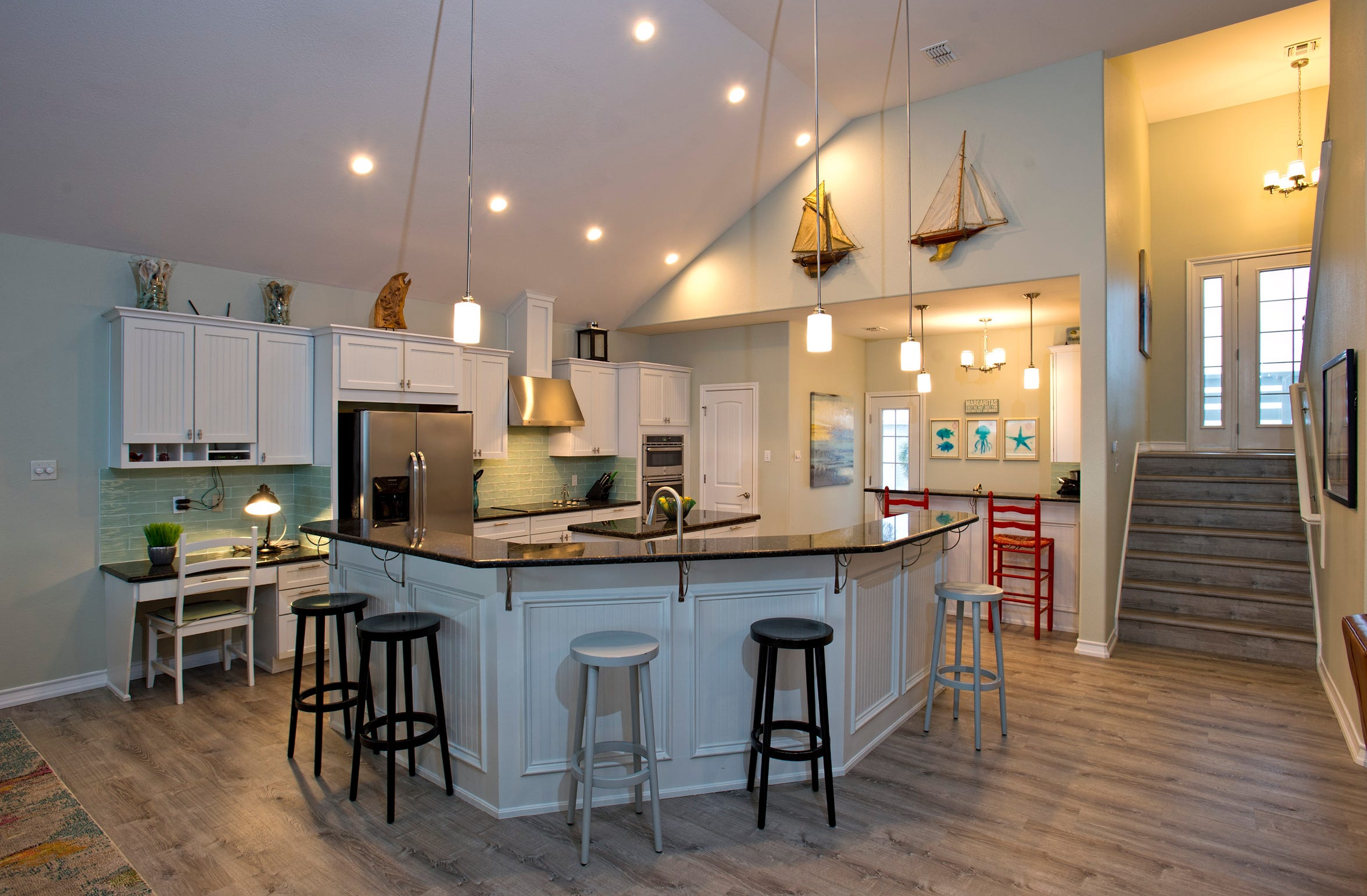 The Large open kitchen features a cool wrap around breakfast bar with plenty of seating to visit and dine plus  a  wet bar and beautiful island  views from every window.